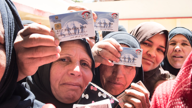 Egyptian Women hold the cash transfer cards.